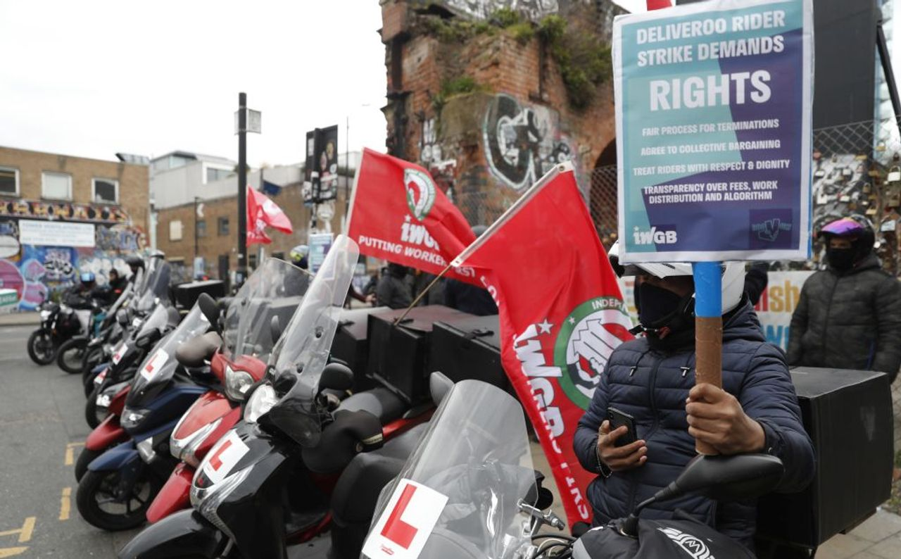Deliveroo workers demand better pay and conditions as company floats on London stock exchange