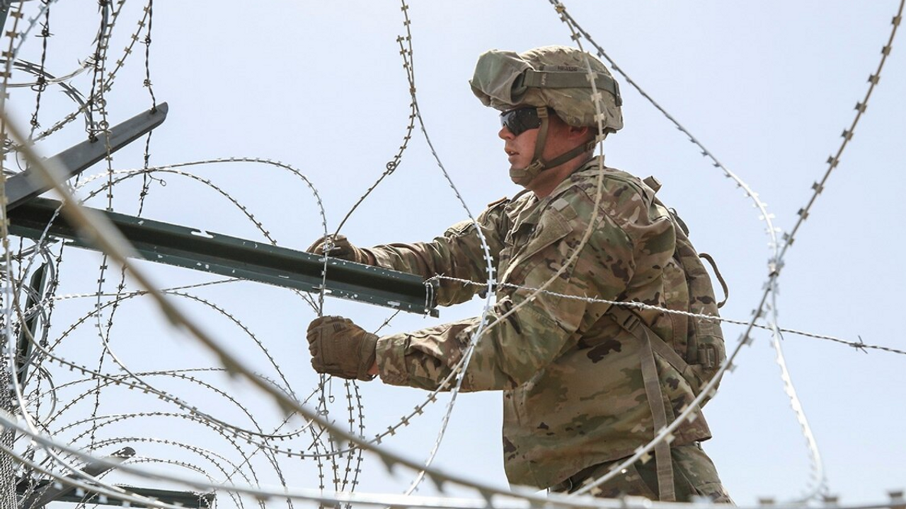 Soldiers secure concertina wire to the existing border fence near the World Trade International Bridge in Laredo, Texas, April 11, 2019. (Sgt. Andrew S. Valles/Army)