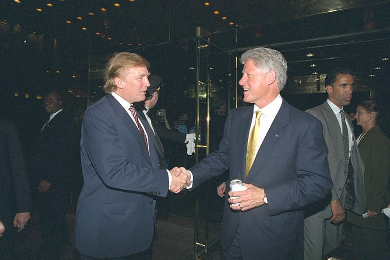 Bill Clinton, right, shaking hands with Donald Trump at Trump Tower in 1999