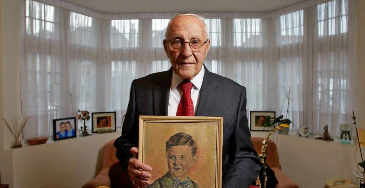 Manfred Goldberg holds a picture of his brother, who was murdered by the Nazis (Credit: Richard Ansett Minnow Films BBC)