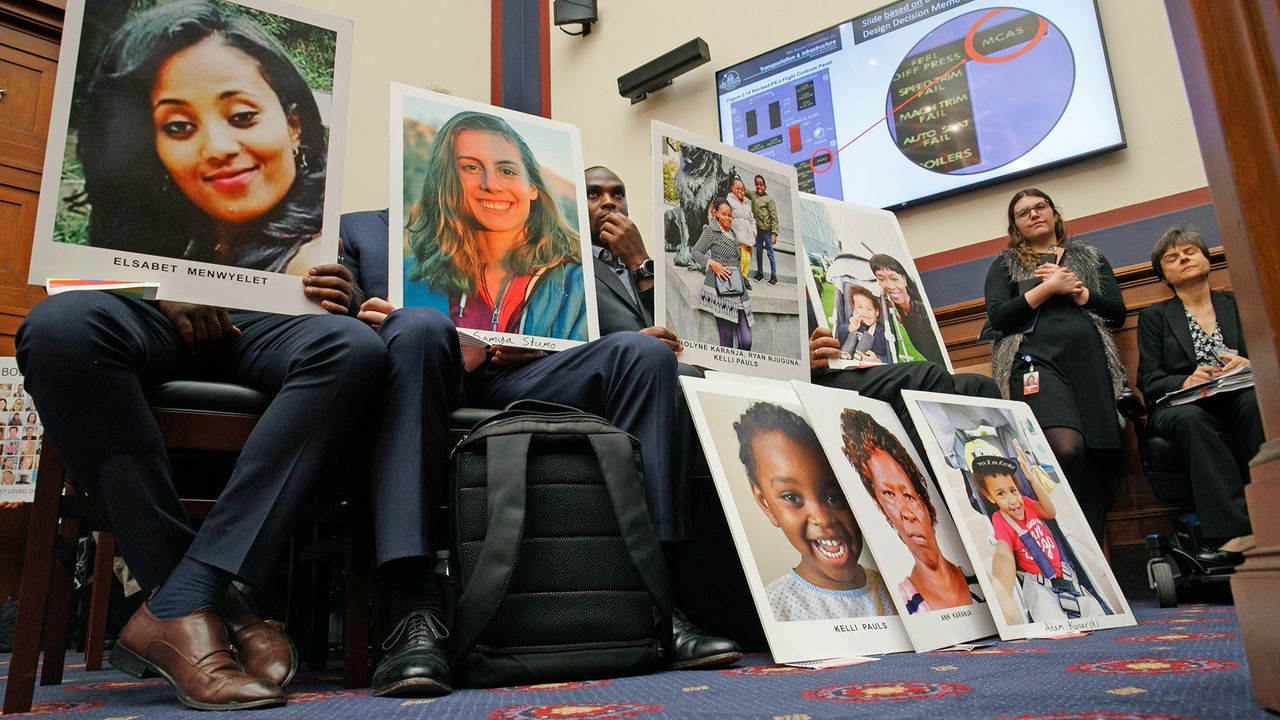 Boeing victims' relatives  with pictures of their killed loved ones