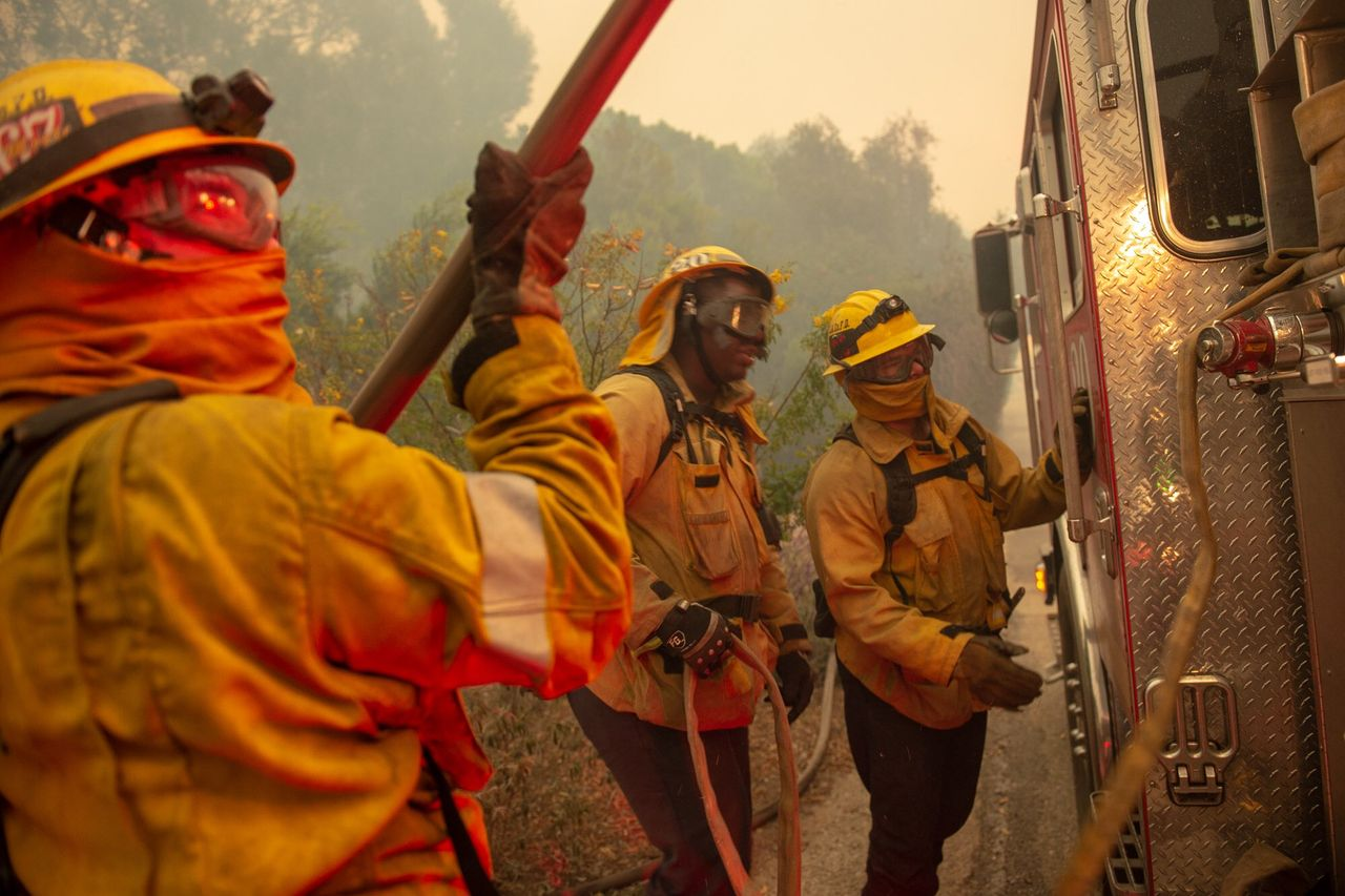 Firefighters taking on the Woolsey Fire in Southern California [photo courtesy Cal Fire]
