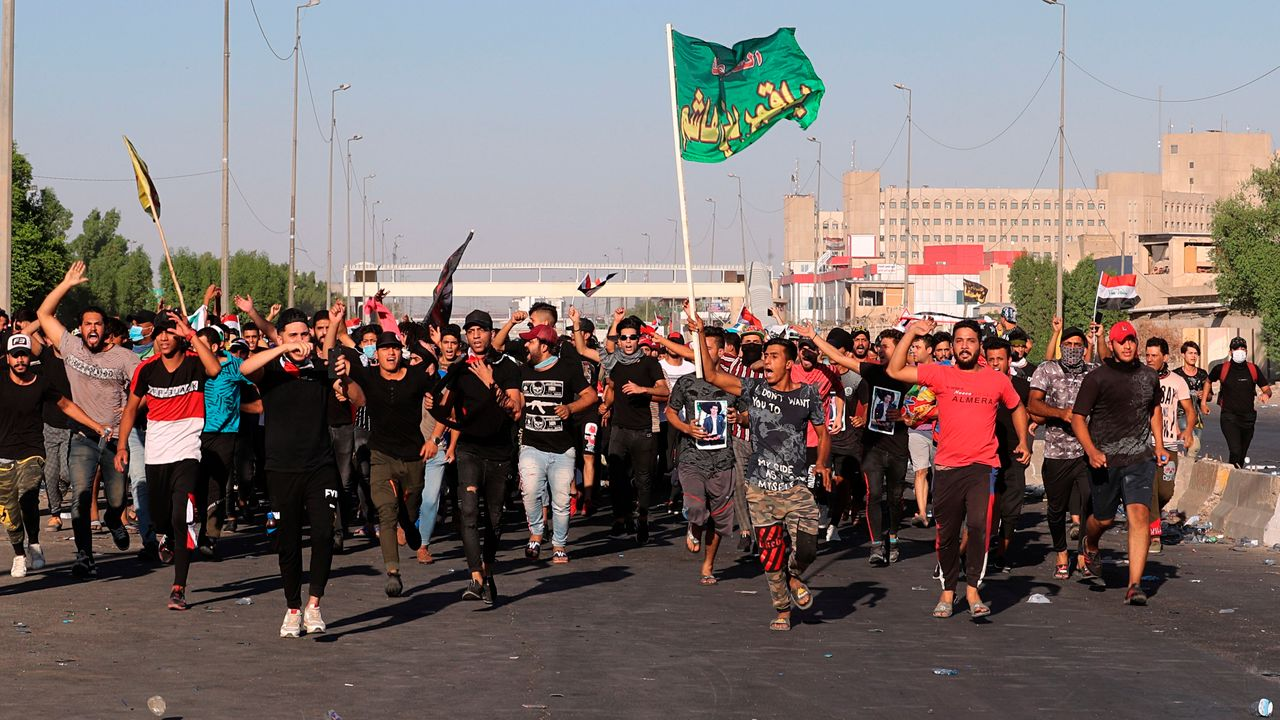 Anti-government protesters chant slogans during a demonstration in Baghdad, Iraq on Friday [Credit: AP Photo/Khalid Mohammed]