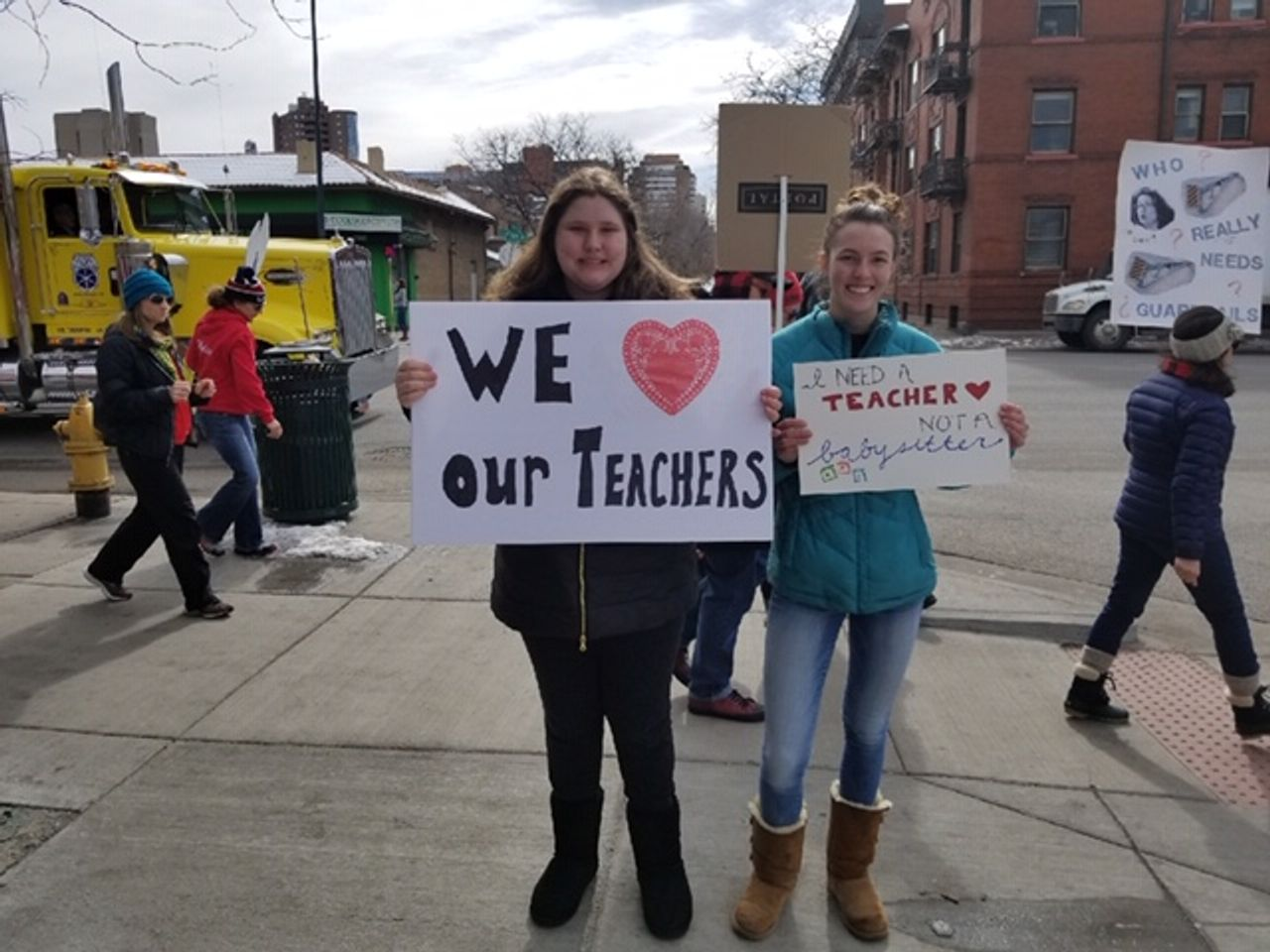 Rebekah and Cathryn marching to support their teachers