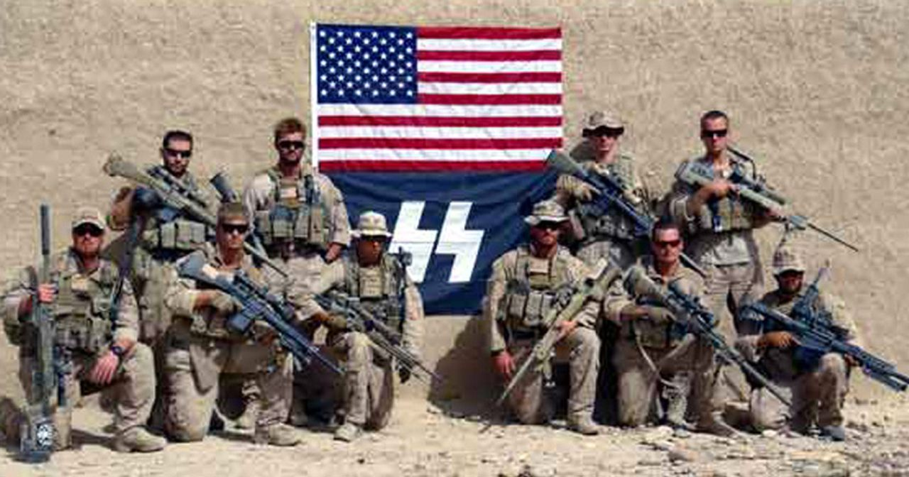 United States snipers pose in front of Nazi SS flag in 2012 (source: Wikimedia Commons)