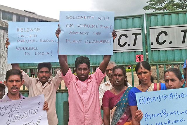 Plantation Workers With Placards Opposing Mass Auto Layoffs In The US And Calling For Defense Of Maruti Suzuki India