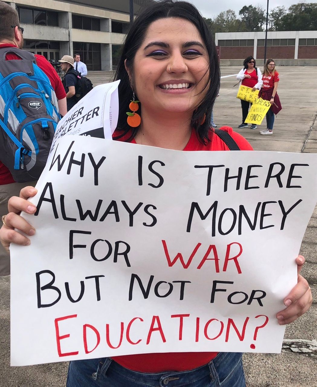 Florida teacher holding sign during Monday's mass protest in Tallahassee to demand increase pay and school funding
