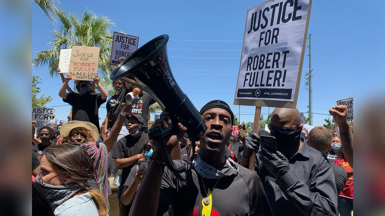 Demonstrators gather in front of Palmdale, California City Hall to demand an investigation into the death of Robert Fuller. [Josie Huang/KPCC/LAist via AP]