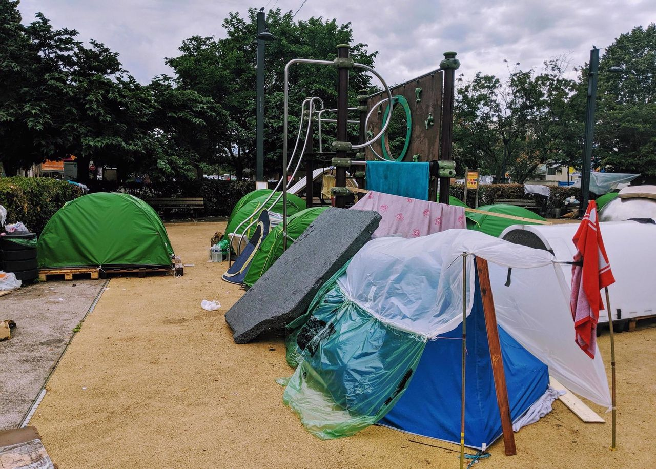 A playground in Saint-Denis converted into a tent camp