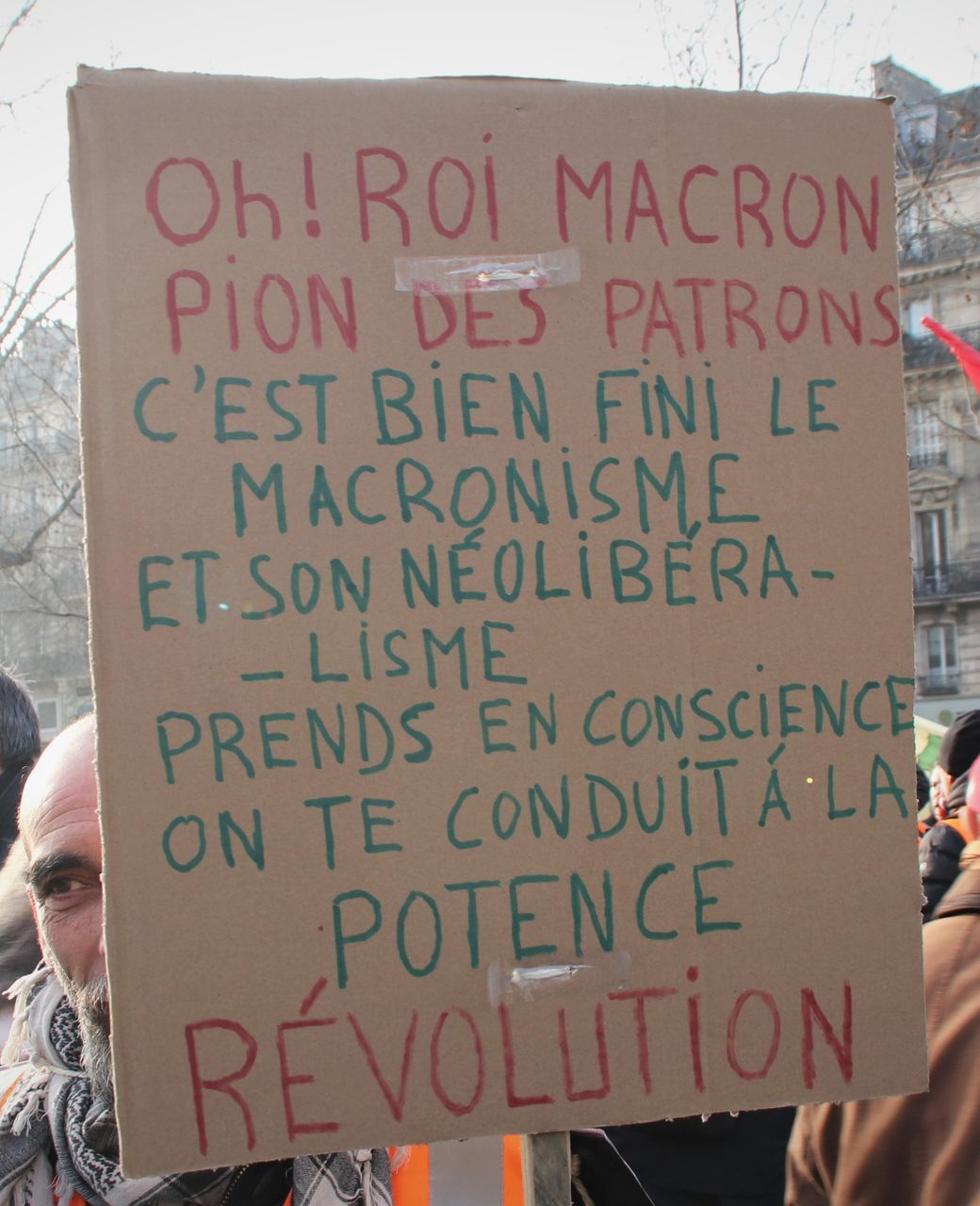Oh King Macron, tool of the bosses, Macronism and neoliberalism are over, you must know we are taking you to the scaffold. Revolution, the sign says