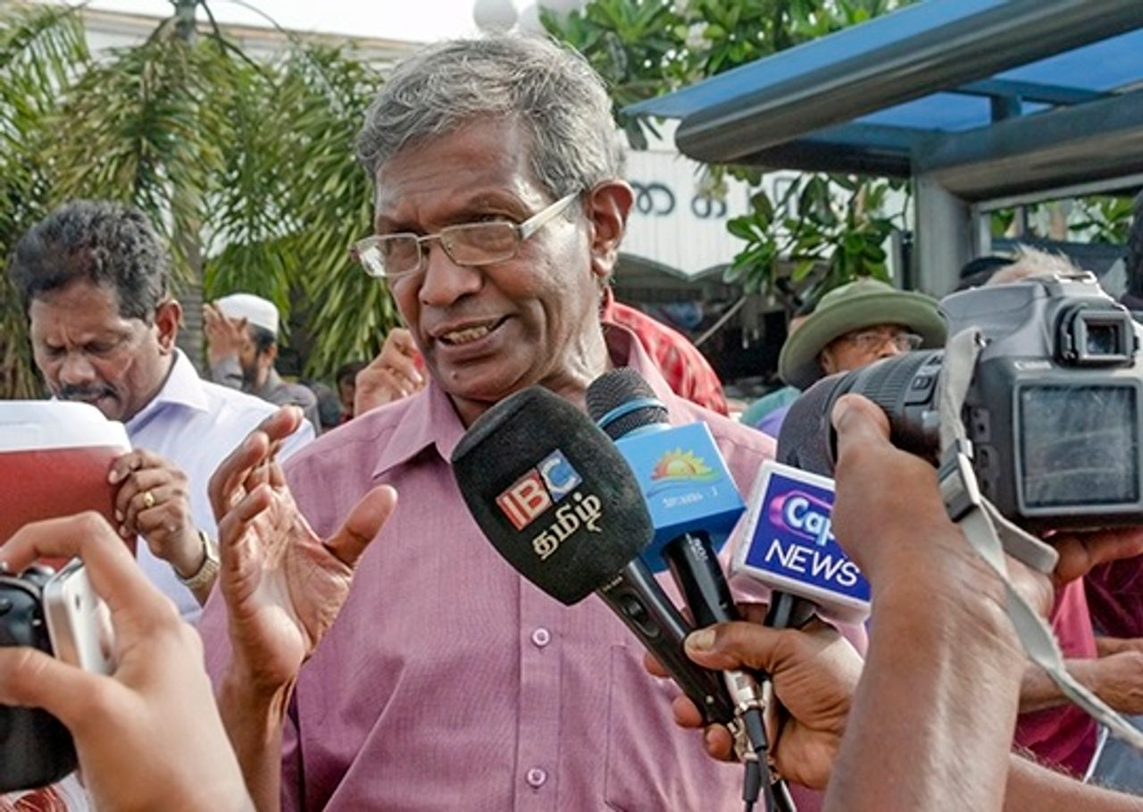 SEP political committee member M. Thevarajah speaking to the media