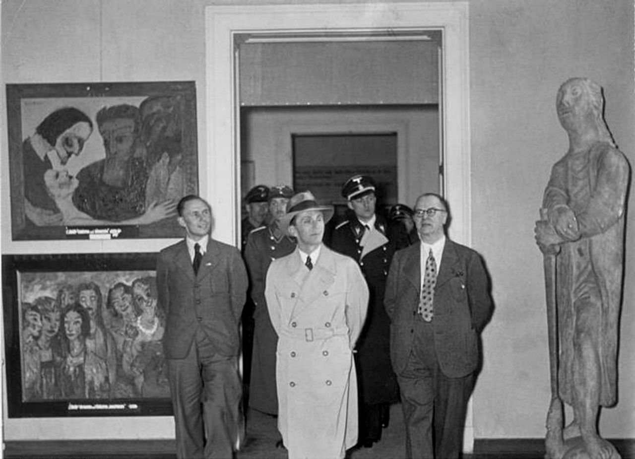 The Degenerate Art exhibition visited by Joseph Goebbels in February 1938, with two paintings by Emil Nolde (hanging left of the door)