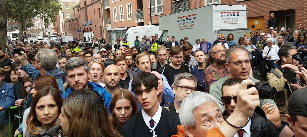The audience standing in the road that was closed to traffic opposite the Home Office as its size grew