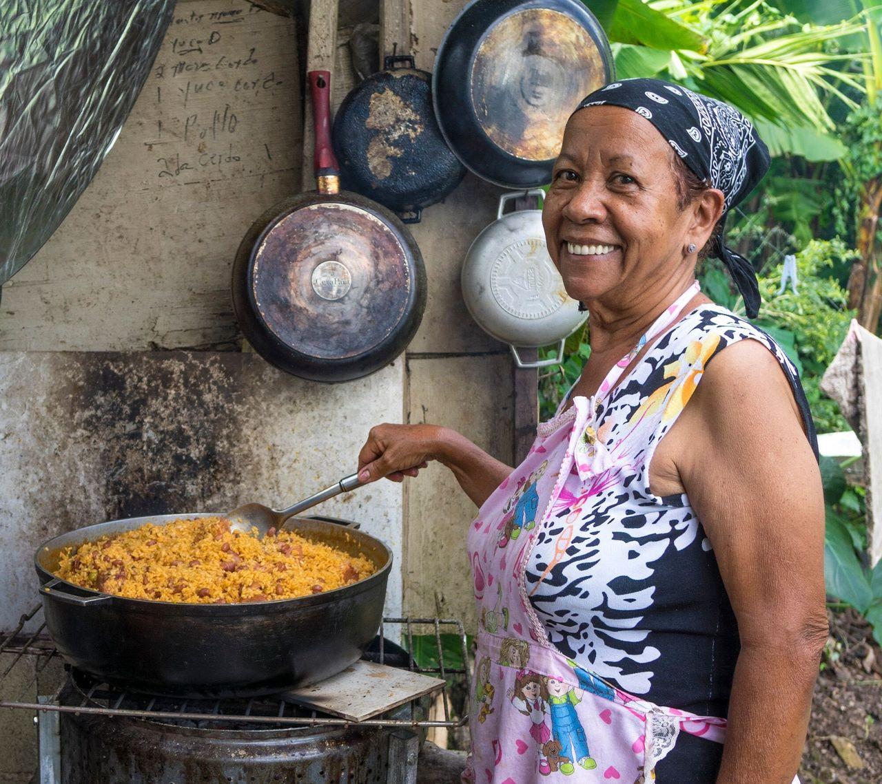 Adelaida Montañez prepares food in her outdoor kitchen