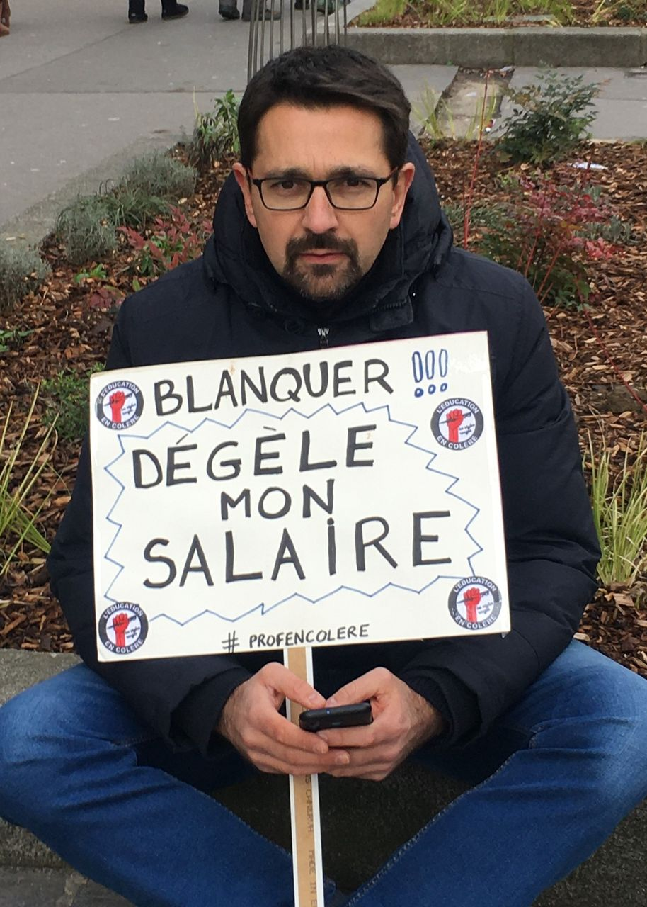 '[Education Minister] Blanquer—End my wage freeze', this teacher's sign says