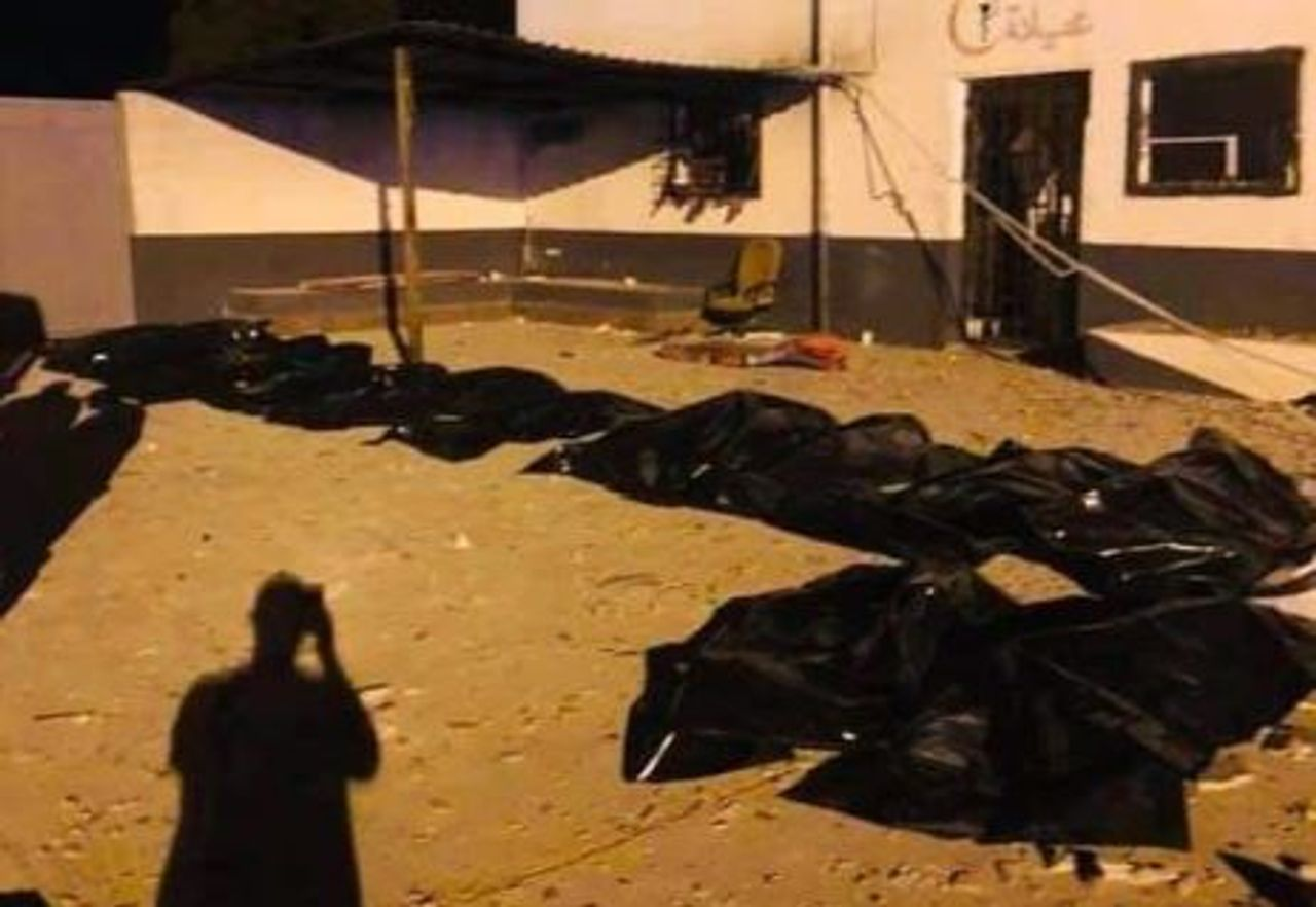 Bodies laid out after bombing of migrant dentention center east of Tripoli. Credit UNHCR