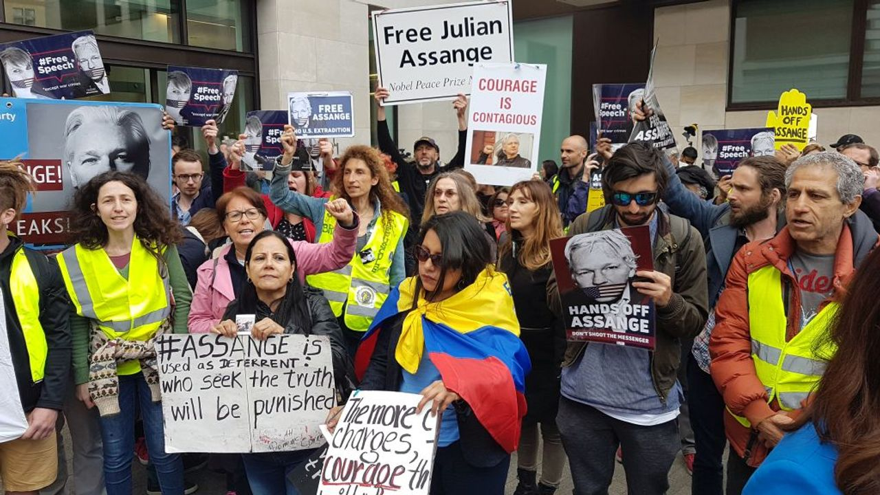 Some of the London, England protesters supporting Assange outside the court