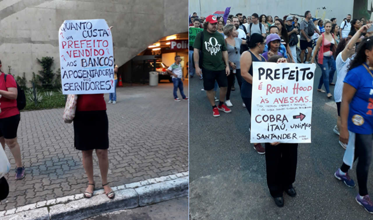 Posters denouncing the São Paulo mayor and the banks: 'How much does a sold-out Mayor cost? For the banks, the public sector workers pensions?' and 'The Mayor is Robin Hood in reverse. He takes away wages and public services, and doesn't charge banks and companies. Charge Itaú, Unimed, Santander.'