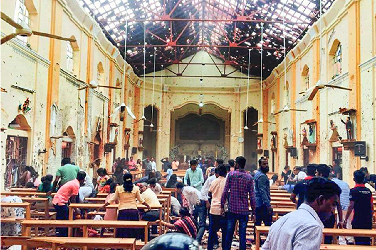 People recovering dead bodies in Katuwapitiya Church