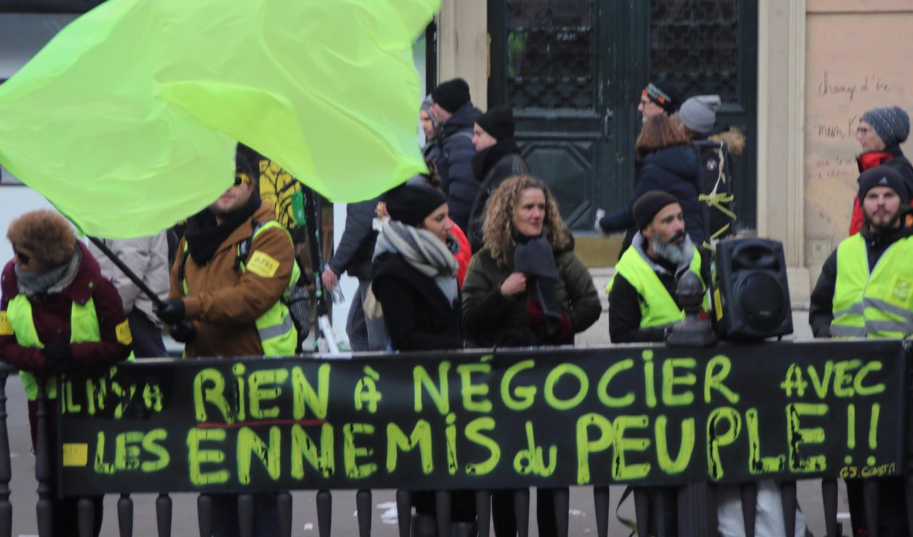 There is nothing to negotiate with enemies of the people, the banner says