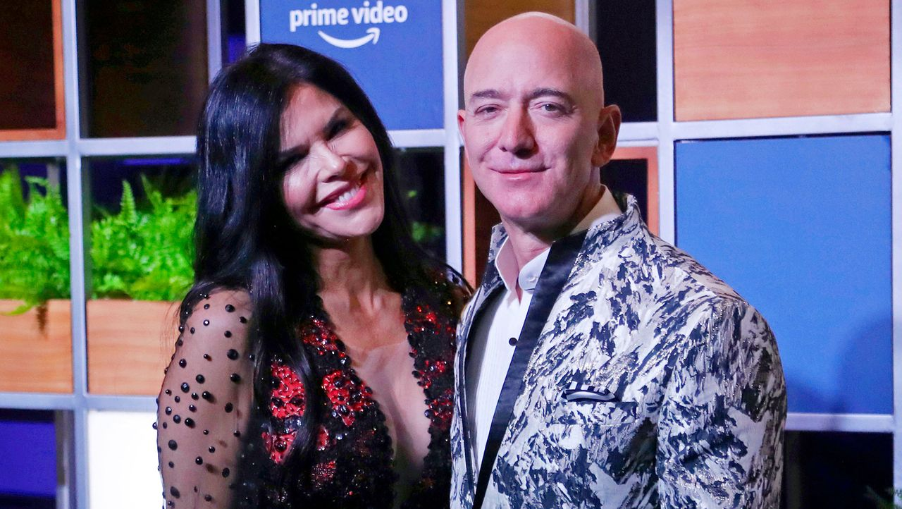 Jeff Bezos and his girlfriend (AP Photo/Rafiq Maqbool, File)