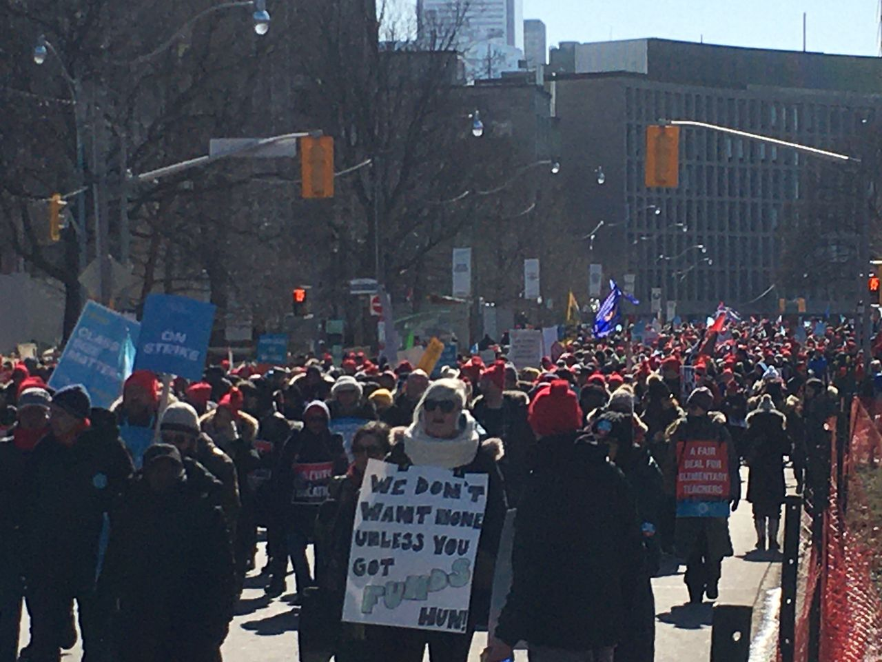 Striking teachers march around Queens Park in Toronto, Canada